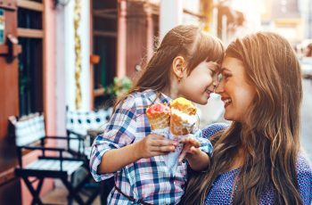 Mother with a daughter eating ice cream